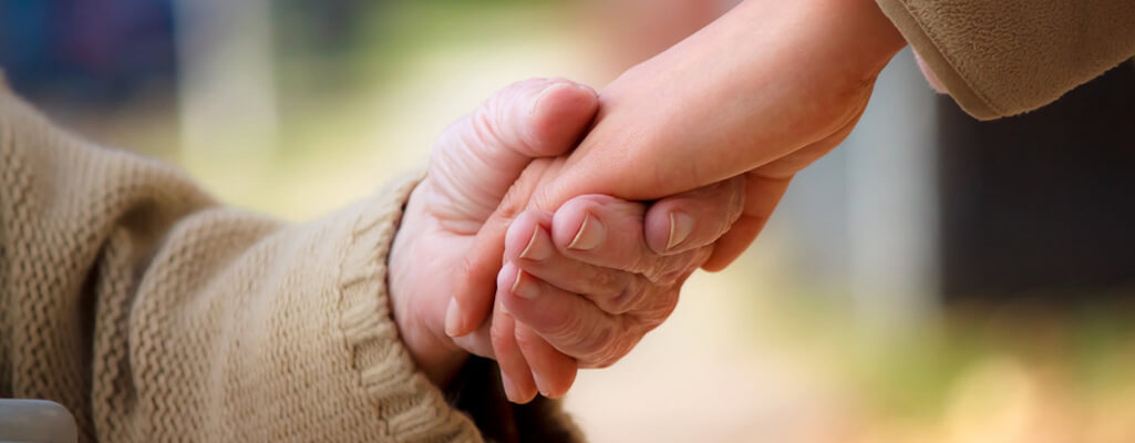 Elderly and Young Hands Holding